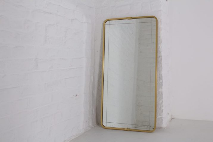Grand miroir mural en laiton
