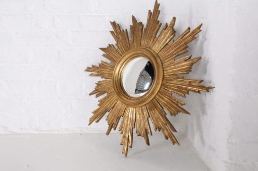 Miroir soleil oeil de sorcière en bois doré