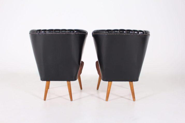 Paire de fauteuils 'Cocktail' noirs.