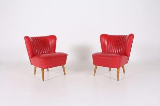 Paire de fauteuils 'Cocktail' rouges.