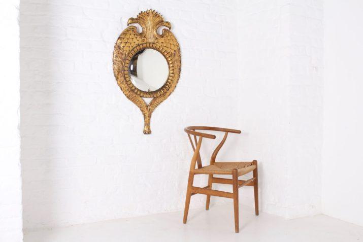 Miroir convexe en bois sculpté doré, aigle bicéphale
