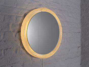 Miroir rond lumineux en plexiglass.